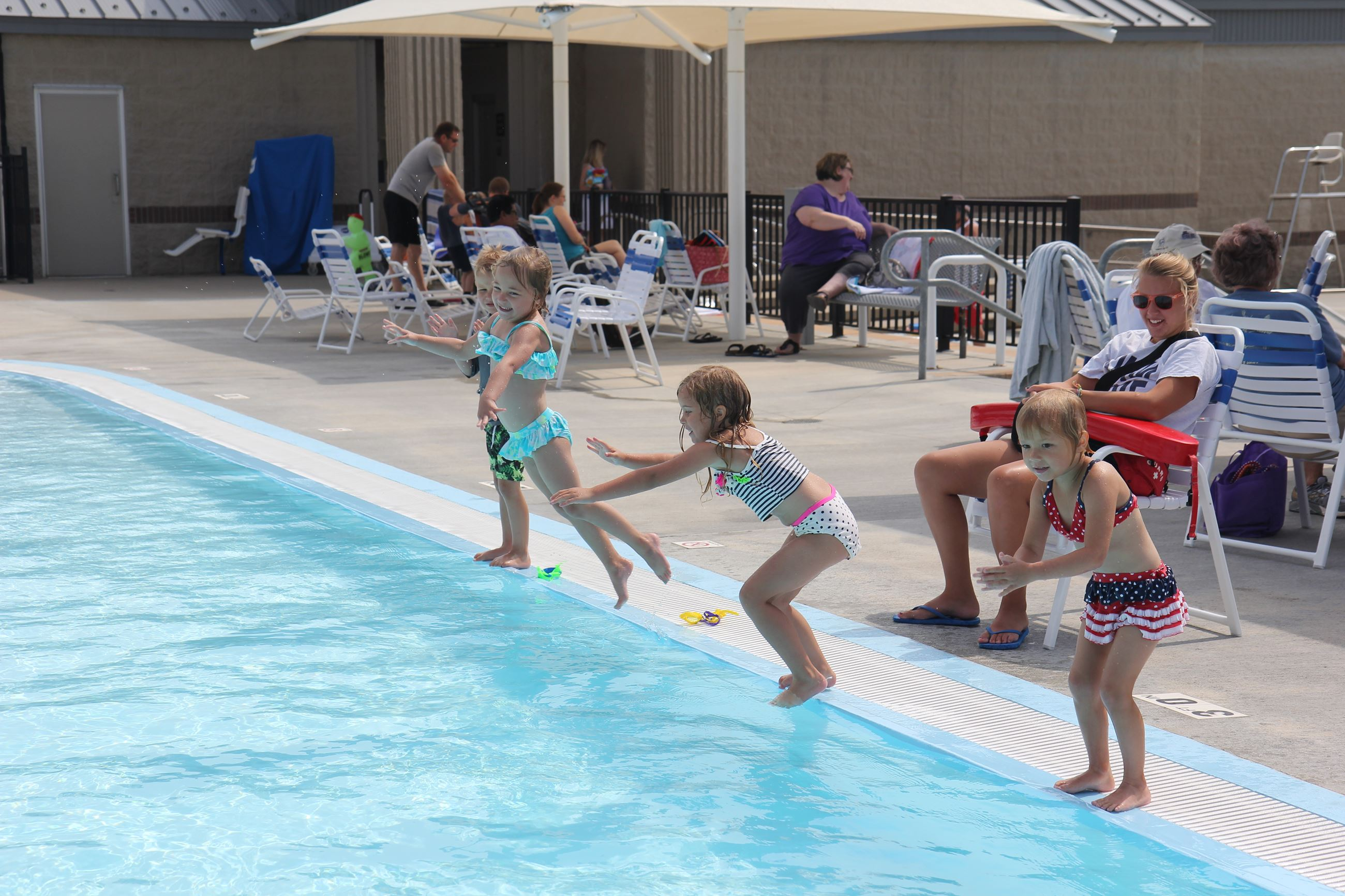 Young children playing at a city pool