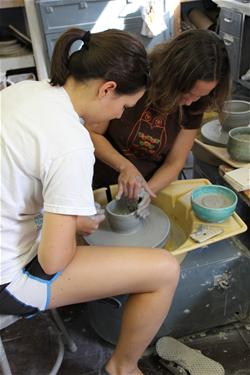 Citizens making clay bowls